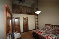 bedroom with bonus loft area
